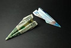 Argent de course (dollars US et euro) Photographie stock libre de droits