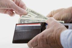 Argent de dépense Image libre de droits