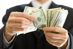 argent de mains d'affaires Photos stock
