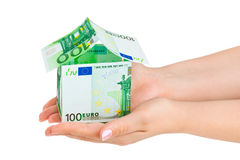 argent de maison de mains Image stock