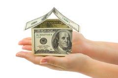 argent de maison de mains Photo stock