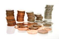 Argent de pièce de monnaie dans les piles Image libre de droits