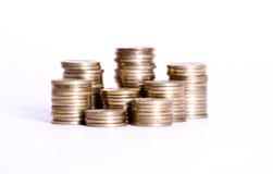 Argent de pièce de monnaie dans les piles Photographie stock libre de droits
