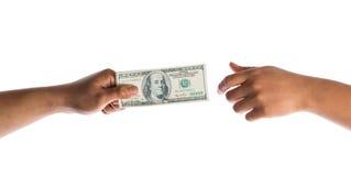 Argent de prise de main en le dollar américain Photographie stock libre de droits
