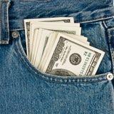 Argent dedans des jeans Photographie stock libre de droits