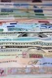 Argent, diverses devises comme fond Photos stock