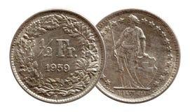 Argent du franc 1959 de pi?ce de monnaie suisse de la Suisse demi d'isolement sur le fond blanc image libre de droits