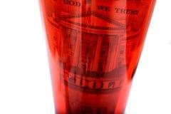 Argent en les dollars en verre rouges Image libre de droits