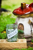 Argent en verre de pot pour l'achat de la maison photographie stock