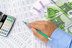 Argent et documents financiers Photographie stock libre de droits