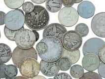 Argent et pièces de monnaie d'isolement sur le blanc Photos stock