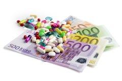 Argent et pilules Photo libre de droits