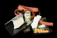 Argent, lame et drogues Photos stock