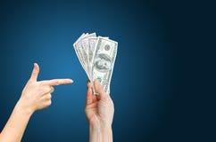 Argent liquide de revenu en dollars Photo libre de droits