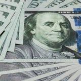 Argent liquide 100 dollars de fond Images libres de droits