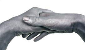 Argent peint par poignée de main Photo libre de droits