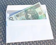Argent polonais dans l'enveloppe Image stock