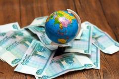 Argent russe et le globe image libre de droits
