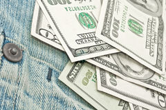 Argent sur la poche de jeans - dollar US Photographie stock libre de droits