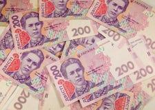 Argent ukrainien Fond de deux cents billets de banque de hryvnia Images libres de droits