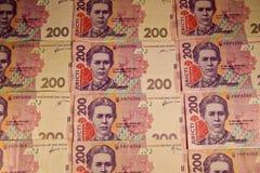 Argent ukrainien Fond de deux cents billets de banque de hryvnia Images stock
