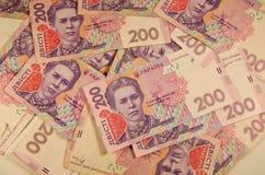 Argent ukrainien Fond de deux cents billets de banque de hryvnia Image libre de droits