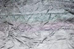 Argentez la tôle froissée est lumière, images abstraites images stock