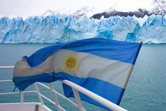 Argentina. Argentinean flag on a boat on the way to Perito Moreno Glacier in Glacier National Park in Patagonia, Argentina Stock Photo