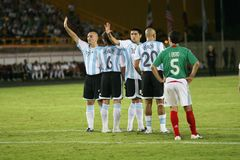 Argentina barrier. Riquelme and Cambiasso are part of this barrier, they are getting instructions from their goalkeeper stock photo