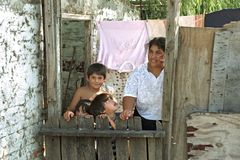 Group portrait Argentine family living in slum. Argentina, Buenos Aires province, city of San Isidro a suburb of great Buenos Aires, with the second largest slum Royalty Free Stock Images