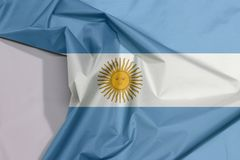 Argentina fabric flag crepe and crease with white space. Argentina fabric flag crepe and crease with white space, a horizontal triband of light blue top and stock image