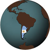 Argentina flag. And territory on map of earth globe royalty free stock photos