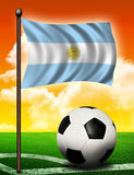 Argentina flag and ball. On soccer field Royalty Free Stock Photos