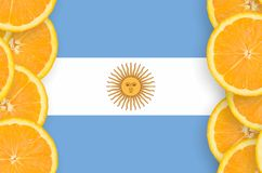 Argentina flag in citrus fruit slices vertical frame. Argentina flag in vertical frame of orange citrus fruit slices. Concept of growing as well as import and royalty free illustration