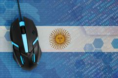Argentina flag and computer mouse. Digital threat, illegal actions on the Internet. Argentina flag and modern backlit computer mouse. The concept of digital royalty free stock image