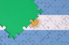 Argentina flag is depicted on a completed jigsaw puzzle with free green copy space on the left side.  vector illustration