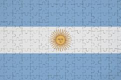 Argentina flag is depicted on a folded puzzle stock image