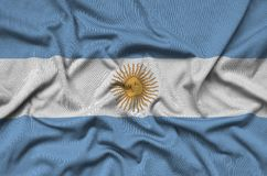 Argentina flag is depicted on a sports cloth fabric with many folds. Sport team banner. Argentina flag is depicted on a sports cloth fabric with many folds stock image