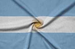 Argentina flag is depicted on a sports cloth fabric with many folds. Sport team banner. Argentina flag is depicted on a sports cloth fabric with many folds stock photography
