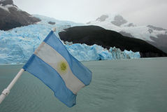 Argentina Flag, lake Argentino. Mountains and glasier royalty free stock images