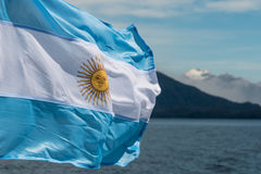 Argentina flag with mountains in background. Closeup of Argentina flag with mountains in background stock photo