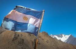 Argentina flag with Nevado Juncal Mountain on background in Cordillera de Los Andes - Mendoza Province, Argentina. Argentina flag with Nevado Juncal Mountain on royalty free stock photography