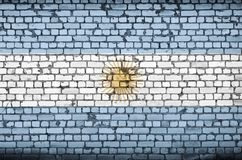 Argentina flag is painted onto an old brick wall. Argentina flag is painted onto an old brick wal royalty free stock photography