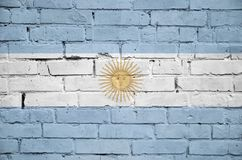 Argentina flag is painted onto an old brick wall royalty free illustration