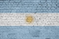 Argentina flag is painted onto an old brick wall vector illustration