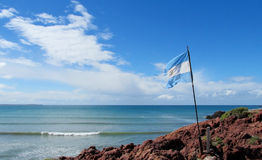 Argentina flag on a sea shore Royalty Free Stock Photography