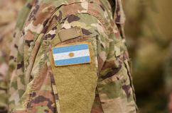 Argentina flag on soldiers arm. Argentina troops collage.  royalty free stock photo