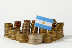 Argentina flag with stack of money coins Stock Photos