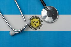 Argentina flag and stethoscope. The concept of medicine. Stethoscope on the flag as a background stock photography
