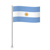 Argentina flag waving on a metallic pole. Royalty Free Stock Photography
